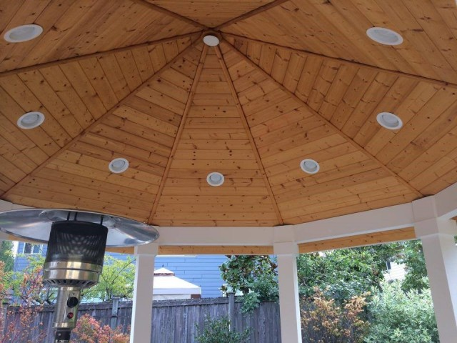 USI Custom Outdoor Living Brings the Outdoors In with a Wood structure with recessed lighting protecting infrared heater.